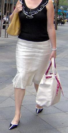 Love this outfit! The sexy crotch wrinkles on her linen skirt make it stand out for me.