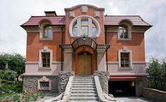 Кирпичный дом оранжевого цвета в стиле модерн