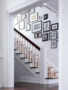 Though this type of stairstep arrangement is more difficult measure and hang, it has a huge impact on a stairwell area.