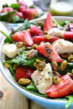 This Strawberry Spinach Salad is an AMAZING twist on a summer classic! Loaded with fresh strawberries, goat cheese, pistachios, and a delicious honey balsamic vinaigrette....this salad is sure to become your new favorite go-to for picnics, cookouts, and everyday meals! If you've been following me for a while now, you know that SALADS are one of my favorite foods ever. And not just because they're healthy, and beautiful, and easy to whip up....but because the possibilities for them are...
