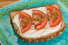 The 50 Healthiest Snacks.  Sate a salt craving  1/2 slice whole-wheat toast brushed with 1/2 tsp olive oil, topped with 1 tbsp Greek yogurt and a mixture of 3 tbsp diced tomatoes with a pinch of chopped garlic and basil (80 calories)*