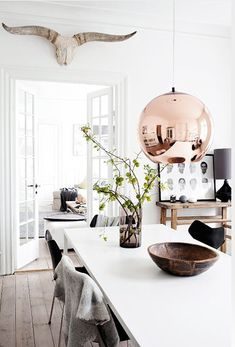 10 rooms featuring a copper pendant lamp