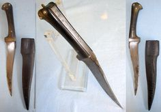 "Afghan pesh-kabz dagger,  made in the Victorian era. It has a heavy 6 ¾"" single edged curved T section blade (10 ¾"" overall). The blade has a sharp cutting edge & narrows to a pin sharp armour piercing point. It has a full tang with integral finger guard. The scales are polished horn fastened to the tang by rivets. The knife is complete with its original leather hide covered wood scabbard. The leather of the scabbard which has a stitched seam is undamaged."