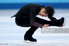 Daisuke Takahashi of Japan competes during the Men's Figure Skating Short Program on day 6 of the Sochi 2014 Winter Olympics at the at Iceberg...