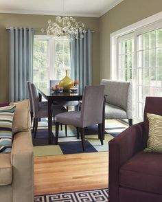 the quiet taupe lets the other colors sing, from the blue-gray draperies to the eggplant and light chartreuse carpet tiles. As seen here and in previous examples, taupe paired with white ceilings and trim provide a refreshing contrast.