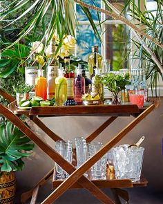 Load up the bar cart — it's #happyhour.Find entertaining tips from @lulupowers in our May issue! (: @johnny_miller_) #fridayvibes