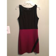 Black and burgundy dress Cute dress with little triangle slit to show off a bit. Worn once in perfect condition. Size medium. Mesmerized Dresses Mini
