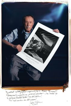 Famous Photographers Pose With Their Most Iconic Images