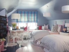 Vibrant, Playful Girls' Bedroom  A neglected attic in a 1946 cottage is transformed into a fun and colorful sister's bedroom.