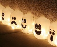 Recycle old plastic milk or juice bottles into quirky Halloween decorations - just cut off the bottoms and add string lights