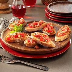 Garlic Tomato Bruschetta Recipe -This appetizer or side dish makes a crispy complement to any Italian entree. I just started with my grandmother's recipe and added fresh tomatoes! It's one of the yummiest bruschetta recipes I've found. —Jean Franzoni, Rutland, Vermont