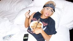 Lady Gaga in bed, eating what looks like cous cous. This is how we all look in bed.