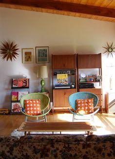 Lovely retro living room with sunburst clocks