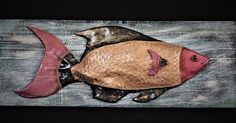Ceramic fish on wood by Ricardo Stefani