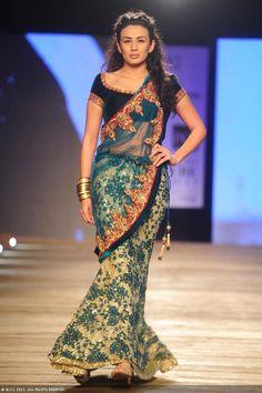 Pia Trivedi walks the ramp for designer Monisha Jaising on Day 2 of Delhi Couture Week, held in New Delhi, on August 01, 2013.