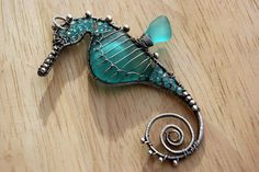 INTENSE AQUA seahorse wire wrapped seaglass pendant..