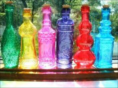 They sell these at old time pottery and the dollar store SHOWER: Table Decos - colorful glass bottles Colored Glass Bottles, Bottles And Jars, Perfume Bottles, Coloured Glass, Glass Jars, Morrocan Theme, Moroccan Party, Arabian Nights Party, Rainbow Glass