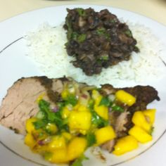 May not look great, but jerk pork tenderloin, mango salsa with black beans and rice tasted amazing!!