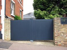 Painted tongue & groove styled driveway gates