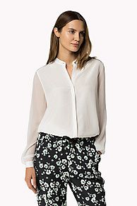 e2701dbff649a0 Shop the white collarless silk blouse and explore the Tommy Hilfiger  clothing… Tommy Hilfiger Outfit