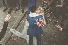 I love how the photographer captured an unexpected hug and sweet, emotional moment between the bride and groom.