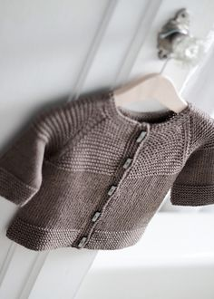 This Garter Yoke Baby Cardigan is a free pattern on Ravelry