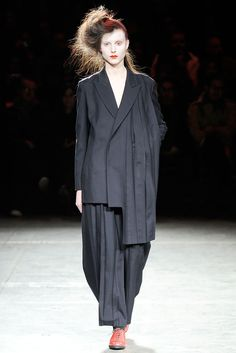 Yamamoto doesn't take notice of traditional proportions within clothing. He often creates oversized, shapeless looks which somehow, through his use of deconstruction, still flatter the body. / Yohji Yamamoto, Fall 2009, Via style.com