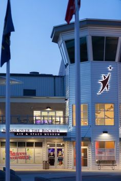 The welcoming entrance of the museum highlights the hangar's historic architecture. The patio with seating can be seen above the main doors. Weddings at Wings Over The Rockies Air & Space Museum in Denver, Colorado.
