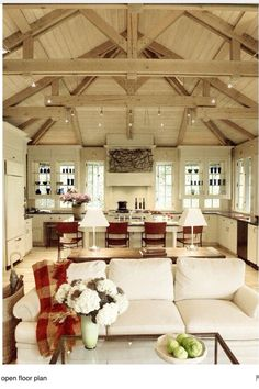 vaulted ceiling w/ exposed trusses.