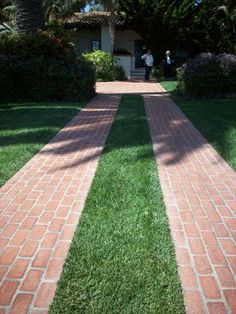 Cobbelstone and grass driveway in arlington ma for Sloped driveway options
