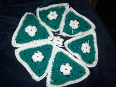 I was wondering if anyone had the pattern for a baby afghan that used this configuration of a small rosette in center surrounded by 6 granny triangles repeated a few times?