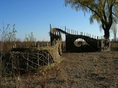 Sculptural willow fence and archway, Toronto Island, Canada. This was part of a dune restoration project.