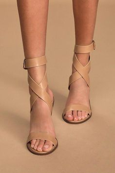 """Kick your everyday look up a notch with the Lulus Shelbie Nude Ankle Strap Heels! Sleek vegan leather creates a wide toe-band, a peep-toe upper, and a matching long ankles strap that wraps and crisscross around the vamp and up the ankle, plus a square gold buckle. Fit: This garment fits true to size. 4"""" stacked wood-look block heel. Cushioned insole. Rubber sole has nonskid markings. All vegan friendly, man made materials. Imported. Lulus 