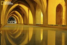 Visiting the 14th-century Alcazar Palace in Seville I was struck by the amazing colors of the hammam and the light playing on the arches with their reflection in the water.    (Photo Courtesy James Birch/National Geographic Your Shot)