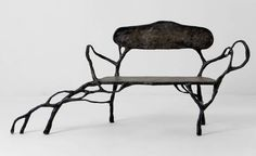 """Dumont bench' by French sculptor Xavier Dumont. Beautifully organic. photo: Anthropologie. via Garden Design"