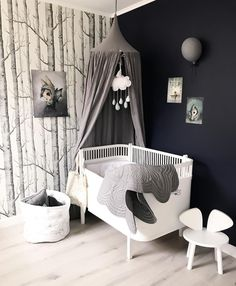 The perfect combination of white, grey and charcoal in this beautiful little boy's room