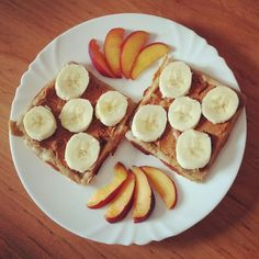 Oatmeal waffles with homemade peanutbutter,banana and nectarin slices