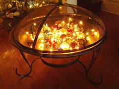 New firepit + white lights + glass ball ornaments = indoor Christmas firepit