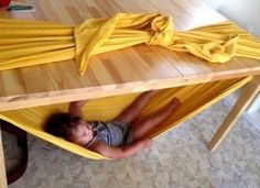 Make a kid hammock with a bed sheet wrapped around the kitchen table. Genius.
