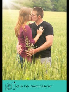Engagement session in a field with sun rays. www.erinlynphotography.com
