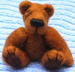A finished needle felted bear. Click for instructions how to make