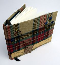 This Guest Book, Scottish themed, personalised and handmade is ideal as a visitor book,guest book, occasion book and sketchbook, fantastic for Scottish weddings. The cover is made from the most gorgeous 100% British Wool tartan in beautiful soft colours that have a comfortable vintage feel and remind me very much of the colours I see on the Northumbrian moors come Autumn time. The lettering and embroidered thistles are done by freehand machine embroidery which is like drawing with the sewing…