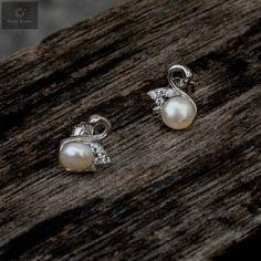 Pure silver studs with pearls and studs that gives beauty for modern women and girls #silver #silverjewellery #pearls #pearljewellery #zirconiastones #studs #silverstuds #beautifulearrings #silverstore #pearlearrings #silverornaments #pearlstuds #earringswithpearls #stonedearrings #earringswithstone