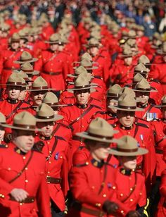 Thousands of RCMP officers march on route to a memorial service to honour their fellow officers who were murdered in Mayerthorpe, Alberta, in 2005. Canada's iconic national police force is facing change in 2008 after a report concluding that its corporate culture is plagued with problems. (Jeff Vinnick/Getty Images)