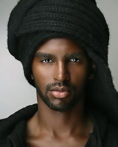 Gorgeous brown skin, deep eyes and full lips.