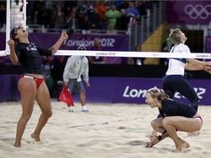 Misty May-Treanor and Kerri Walsh Jennings celebrating their beach volleyball victory over Australia's Cook & Hinchley.