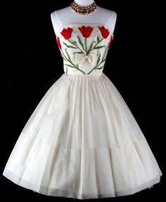 Wedding Dress: 1950's, ivory sheer organza, red + green tulip embroidery, acetate lining.