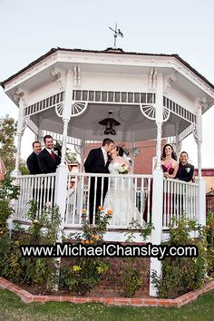 Bride and Groom along with the bridal party pose for a formal portrait after a wedding ceremony inside gazebo at Trail Dust Town by Savoy Opera House in Tucson AZ Arizona. Photo by Michael Chansley Photography wedding photographer poses idea ideas
