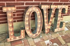 wood and metal marquee sign that lights up your love