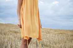 woman wearing yellow dress standing on green grass field Beautiful, free Girl photos from the world for everyone - Infinity Collections Clothing Blogs, Dress Stand, Tent Dress, Short Sleeve Dresses, Dresses With Sleeves, After Life, Fashion Essentials, Summer Essentials, Yellow Dress